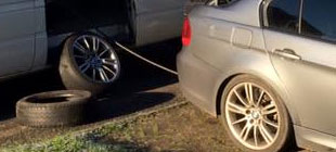 BMW tyre being replaced by mobile tyre fitter